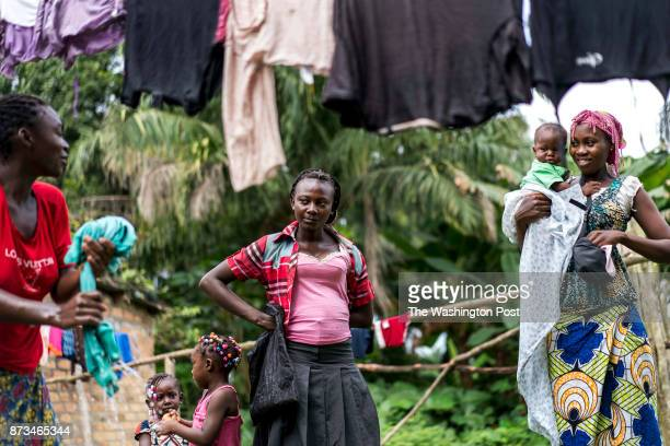 CONGO Women and kids stand around the clothes line talk and do laundry in the small northeastern Republic of Congo city of Impfondo Republic of Congo...