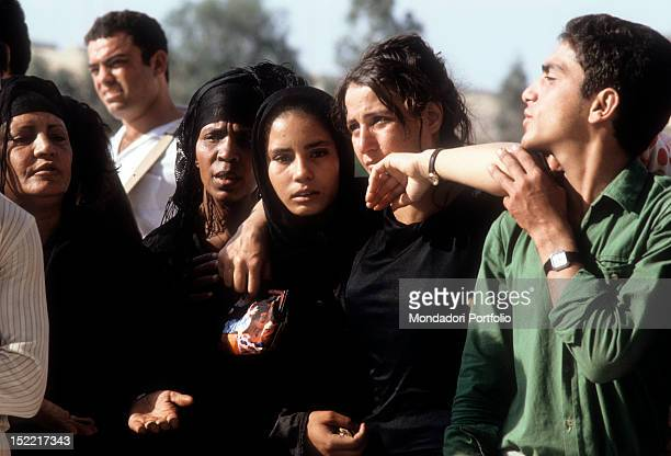 Women and man assist grieves at President Sadat Funerals sadat was assassinated on October 6 by a terrorist Medinet Nars