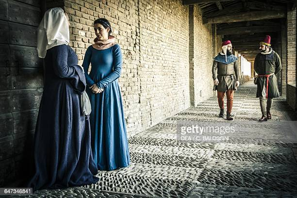 Women and men in the Rocca Sforzesca of Imola Italy mid14th century Historical reenactment
