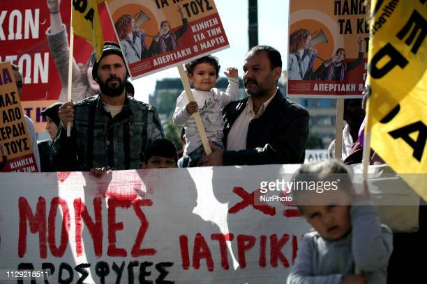 Women and men protest against violence and racism to mark International Womens Day in Athens Greece on March 8 2019 Protesters demand equality and...
