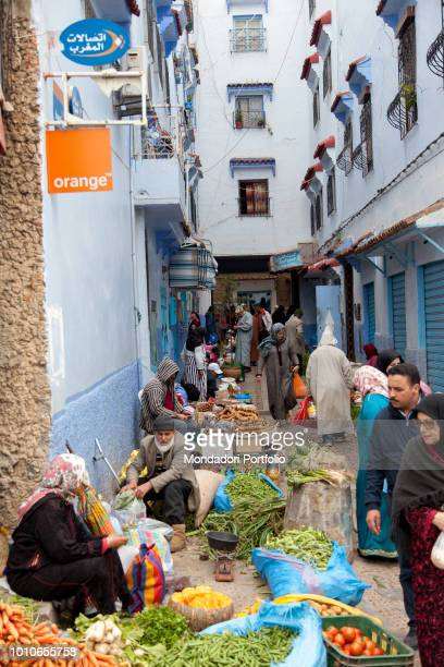 Women and men sell the products of their earth fruit and vegetables to the market in a street of Chefchaouen April 2018
