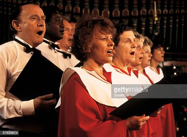 women and men singing in a church choir