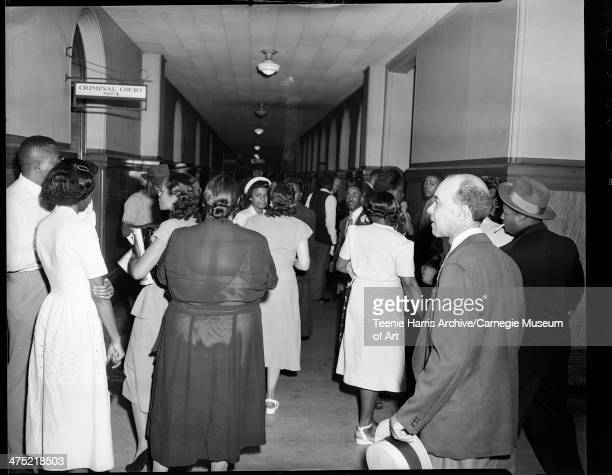 Women and men walking in hallway outside of Criminal Court No 3, in Allegheny County Courthouse, Pittsburgh, Pennsylvania, June 1949.