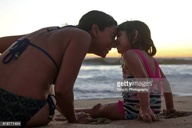 Women and the little girl on the beach
