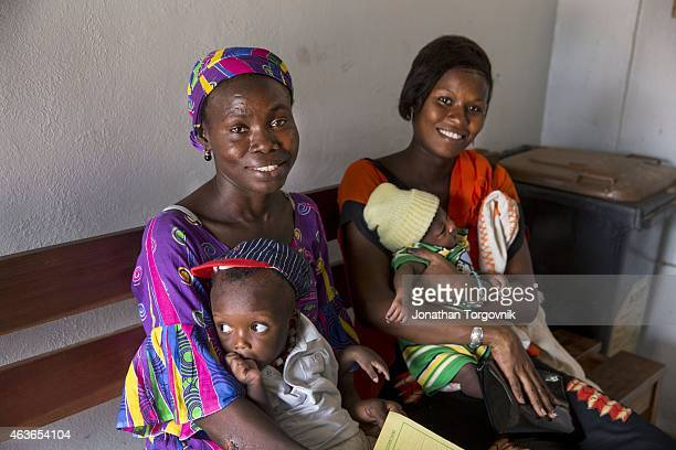 Women and their babies receiving post natal care at a health center August 18 2014 in Guediawye Senegal