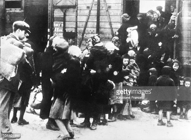 Women and young children getting out of a stock car at the arrival of the Auschwitz concentration camp