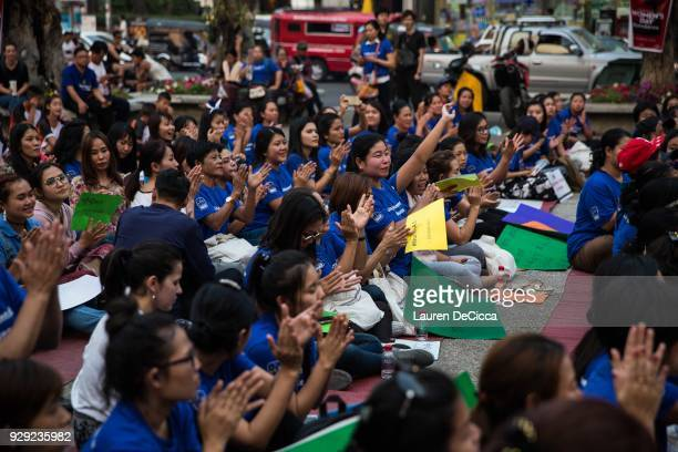 Women applaud at Tha Pae Gate during the annual International Women's Day event on March 8 2018 in Chiang Mai Thailand Hundreds of women from several...