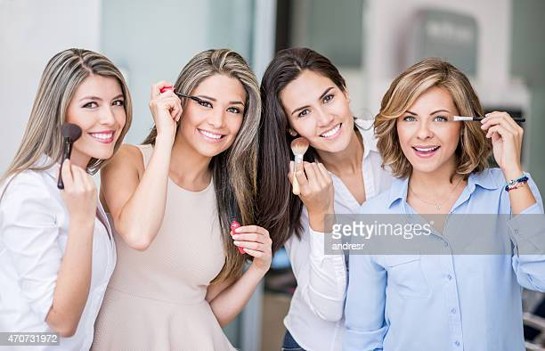 Women applying make up