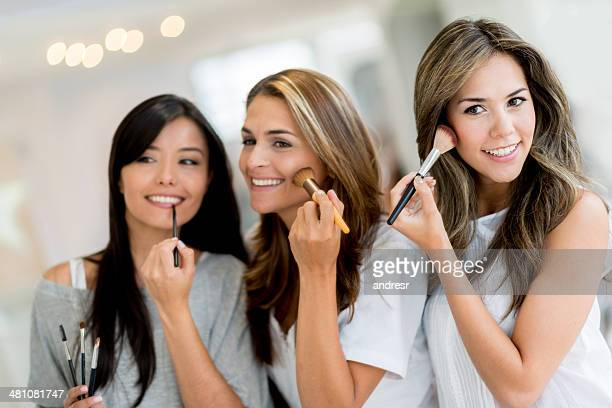 Women applying make up
