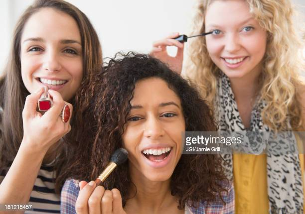 women applying makeup together - vanity stock pictures, royalty-free photos & images