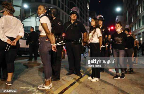 Women are arrested downtown by police after curfew went into effect during demonstrations over George Floyd's death on June 2 2020 in Los Angeles...