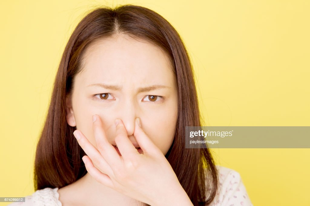Women are pinching the nose : Stock Photo