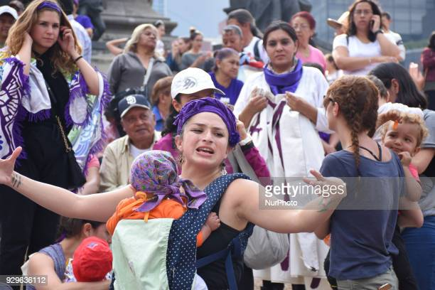 Women are see meeting at Angel of Independence to start a march against of Femicide and celebrating International Women's Day on February 08 2018 in...