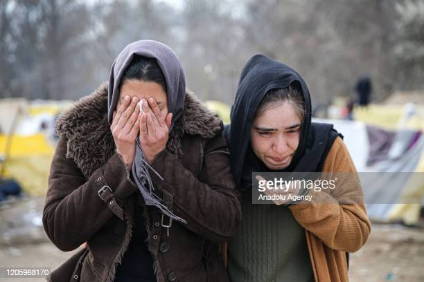 Women are seen affected from tear gas used by Greek security forces to disperse asylum seekers in the region between the Kastanies and the Pazarkule...