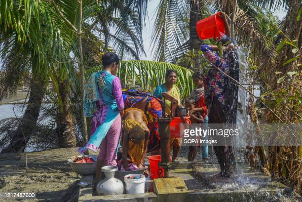 Women are seen collecting drinking water from a local tube-well in the aftermath of the extremely severe cyclonic storm Amphan. Thousands of shrimp...