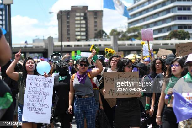 Women are seen marching along the street during the International Women's Day demonstration, in Guatemala City, on March 8, 2020. - Women around the...