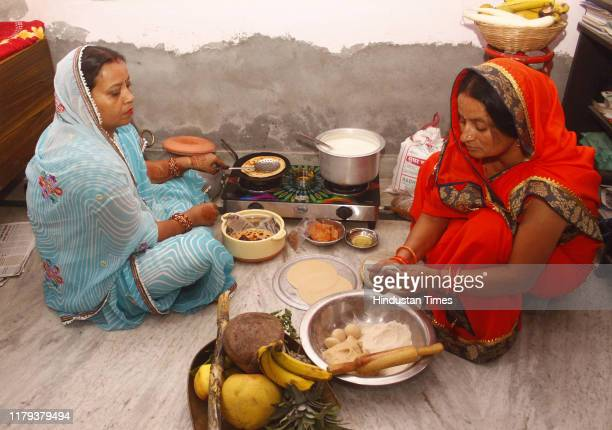 Women are seen preparing dinner after observing a fast during the day for 'Kharna Puja' part of the Chhath Puja festival at Rajendra Park on November...