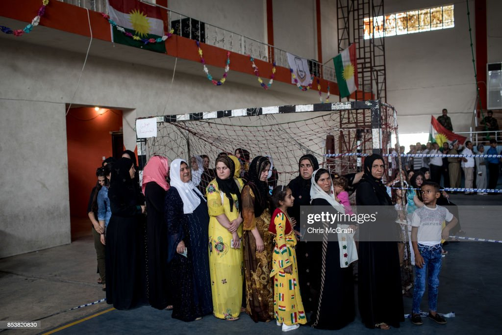 Women are seen waiting in line to cast their referendum vote at a voting station on September 25, 2017 in Erbil, Iraq. Despite strong objection from neighboring countries and the Iraqi government, some five million Kurds took to the polls today across three provinces in the historic independence referendum.