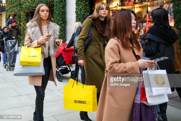 Women are seen with shopping bags on Londons Oxford Street with 3 days to Christmas Day Retailers are expecting a rush of shoppers in the leadup to...