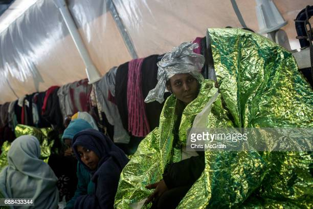 Women are seen wrapped in thermal blankets on board the Migrant Offshore Aid Station 'Phoenix' vessel on May 25 2017 off Lampedusa Italy The crew of...