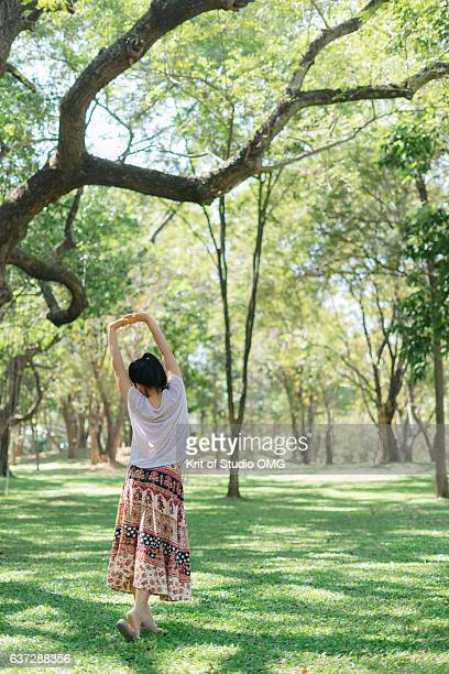 women are stretched under the tree - under the skirt stock photos and pictures