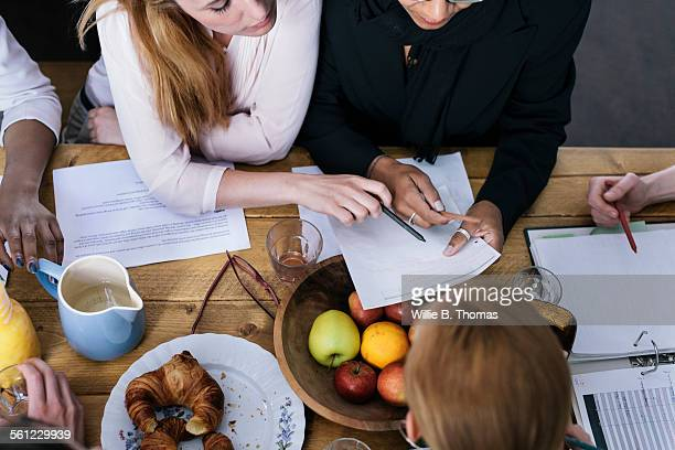Women around table having a business meeting