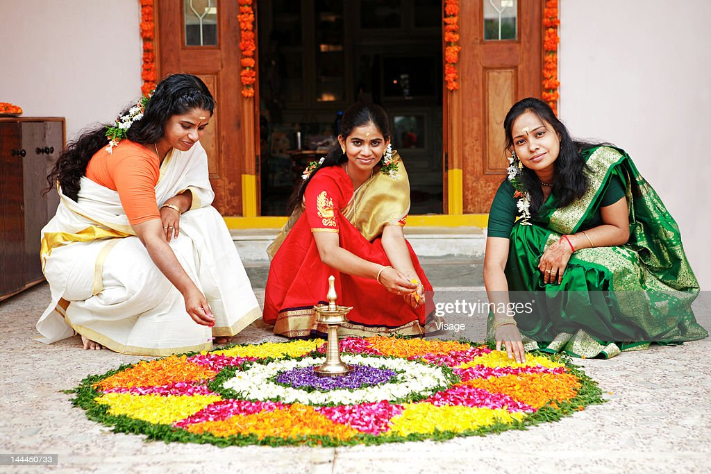 Women arranging a floral decoration : Stock Photo