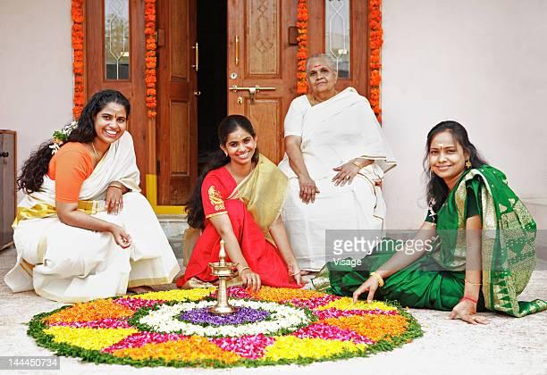 Women arranging a floral decoration