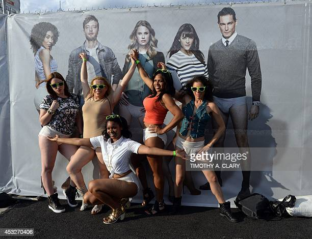 Women arrive at Pier 97 in New York August 6 2014 for the 'Drop Your Pants and Dance for Underwareness' to help support the 65 million Americans who...