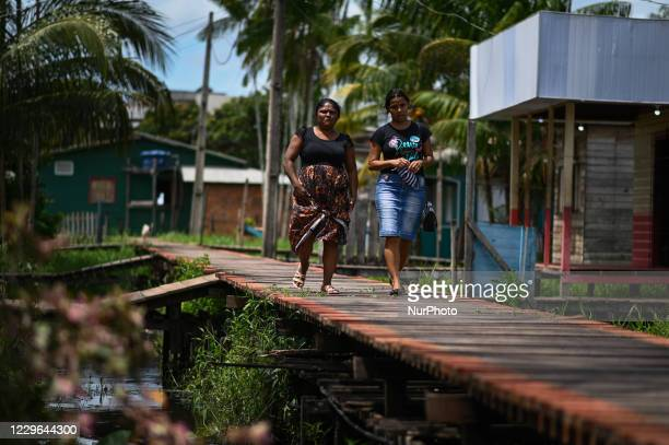 Women arrive to vote during municipal elections amid the Coronavirus pandemic in Santana, Amapá State, Brazil, on November 15, 2020. The population...