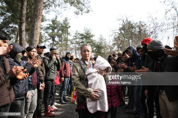 Women Asylum Seekers waiting at Turkey's Pazarkule border crossing to reach Europe stage a demonstration at the buffer zone demanding to open the...
