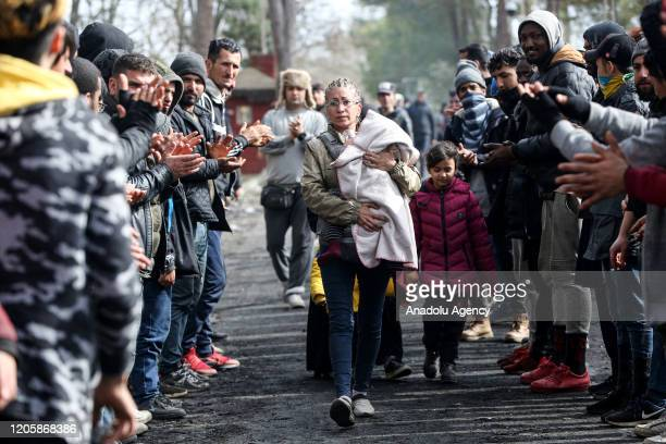 Women Asylum Seekers, waiting at Turkey's Pazarkule border crossing to reach Europe, stage a demonstration at the buffer zone demanding to open the...