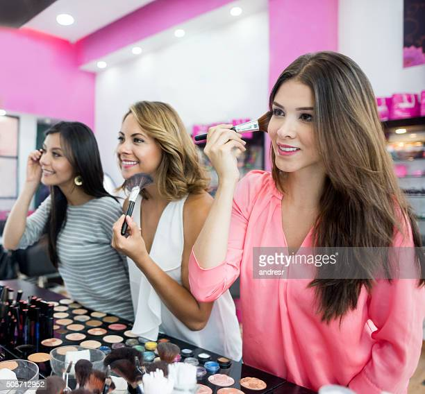 Women at a beauty store trying some makeup