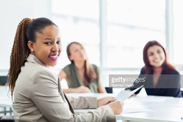 Women at a meeting in a conference room