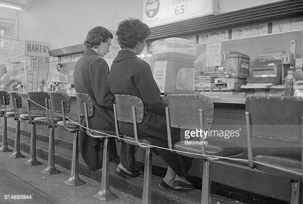Women at a ropedoff lunch counter stage a sit down to protest segregation in Nashville Tennessee