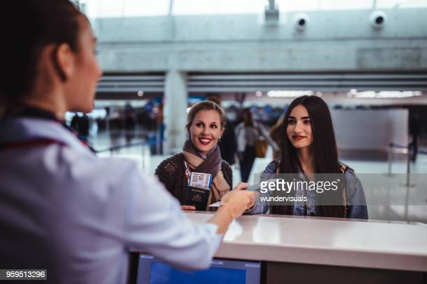 Women at airport doing check-in at airline counter