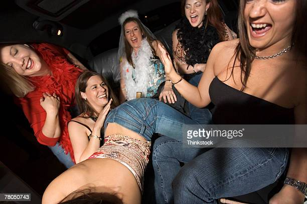 women at bachelorette party - spanking stock photos and pictures