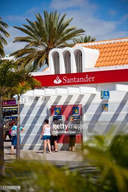 Women at cash machines of Santander bank in Playa de las Americas Costa Adeje on March 25 2011 in Tenerife Spain Tenerife is the biggest of the...