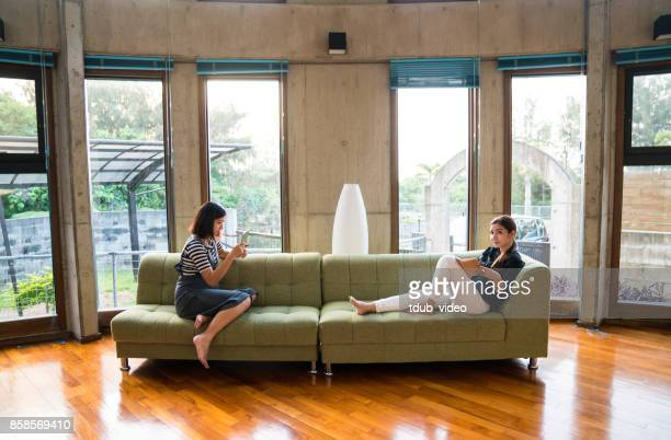women at home - tdub_video stock pictures, royalty-free photos & images