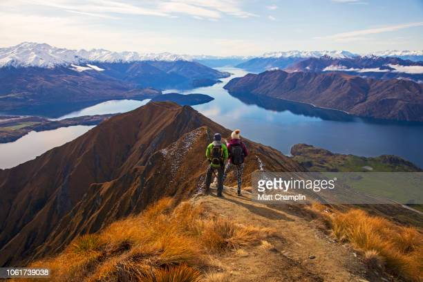 women at summit of mt. roy in new zealand - new zealand bildbanksfoton och bilder
