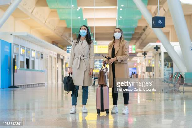 women at the airport in covid-19 time - italy stock pictures, royalty-free photos & images