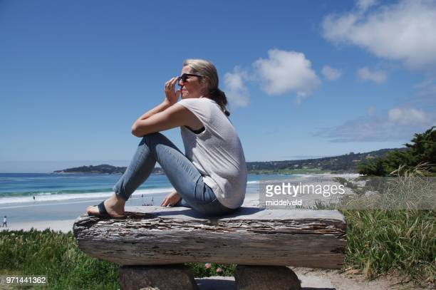 women at  the beach - 50 59 years stock pictures, royalty-free photos & images