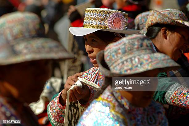 Women at the market wearing the traditional hat