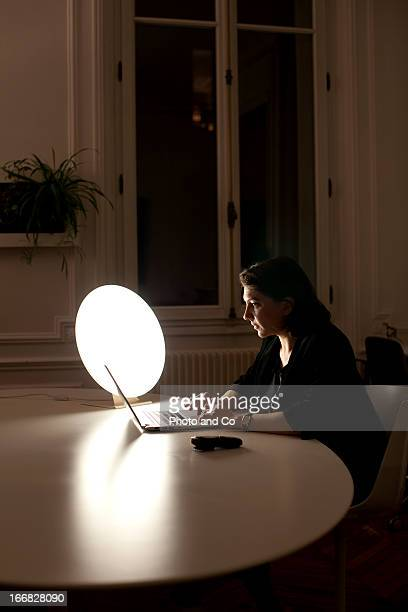 women at the office with light therapy lamp