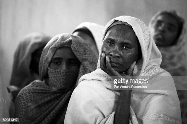Women at the Oure Cassoni refugee camp on July 26, 2007 about 23 kilometers outside Bahai, Chad. Since 2003, Darfur's Janjawid militia and the...
