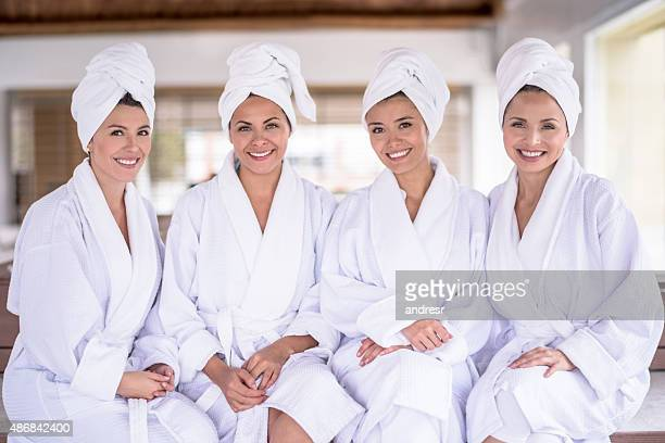 women at the spa - wrapped in a towel stock pictures, royalty-free photos & images