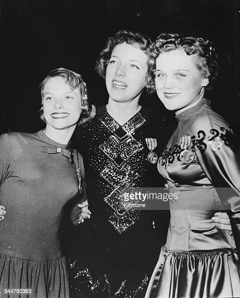 Women at the World Figure Skating Championships; (L-R Carol Hess, Tenley Albright and Hanna Eigel, are the medal winning skaters in the final,...