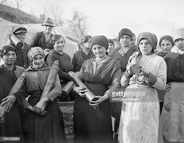 Women At Work During The First World War A group of young Italian women employed by the British Army to unload artillery ammunition at a railhead...