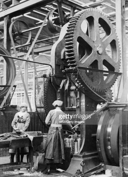 Women At Work During The First World War Two women operate a shell case forming machine at the New Gun Factory of the Royal Arsenal Woolwich May 1918