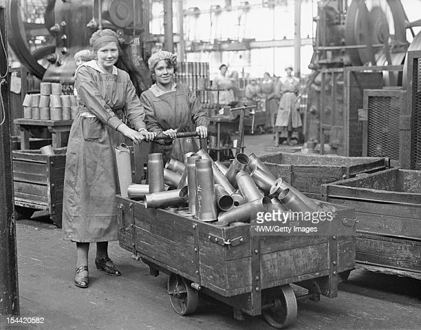 Women At Work During The First World War Two women war workers push a truck load of shell cases in the New Case Shop at the Royal Arsenal Woolwich...